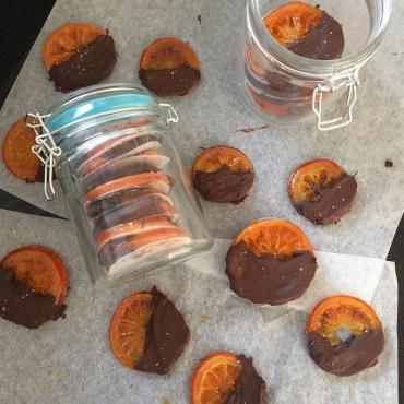 Finished crystallised oranges in a kilner jar