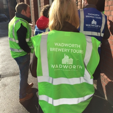Wearing a high-vis jacket during the Wadworth Brewery Tour in Devizes